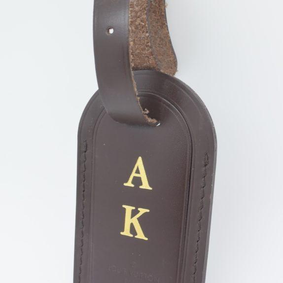 Louis Vuitton Adressanhänger braun A K